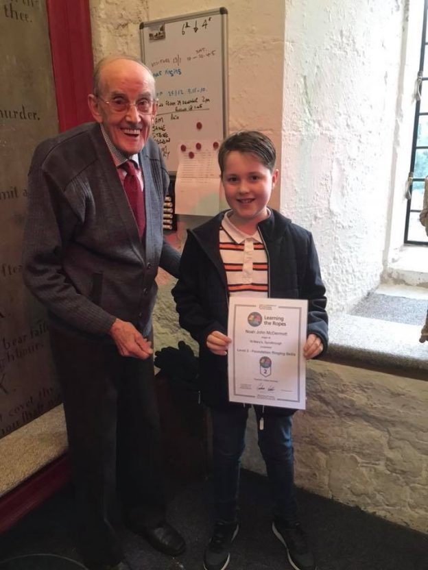 Noah receiving his level 2 certificate from Cyril